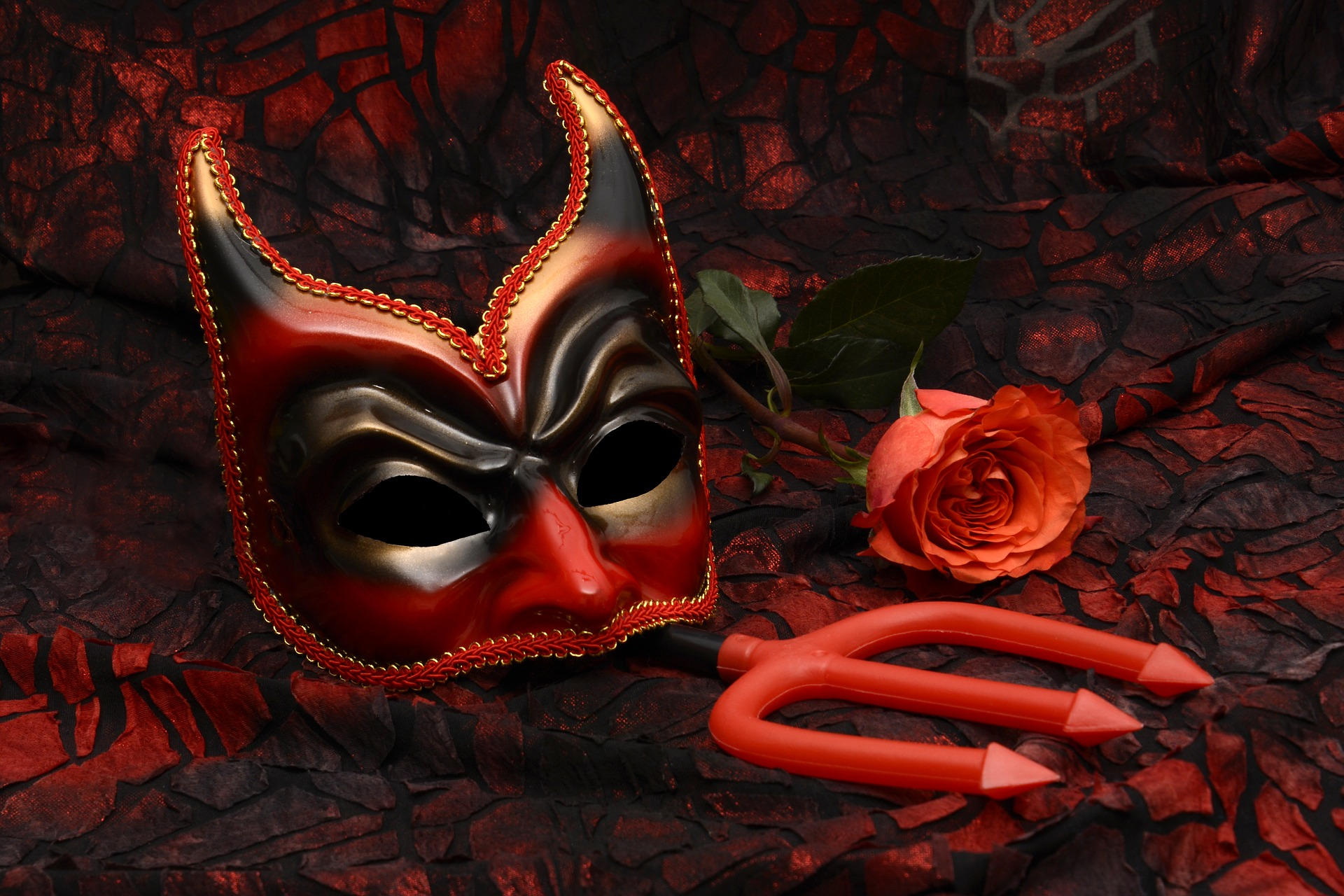 Demon mask, trident and red rose